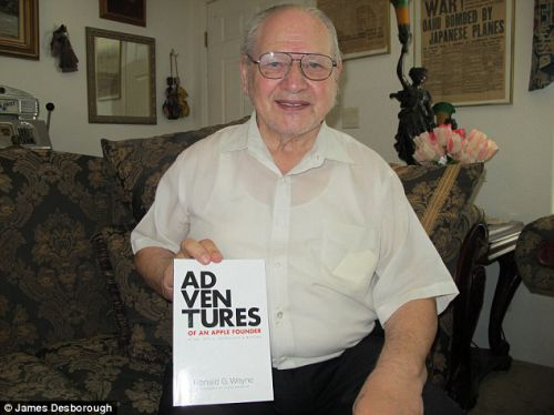 Ron Wayne, the forgotten founder of Apple, pictured with a copy of his autobiography.